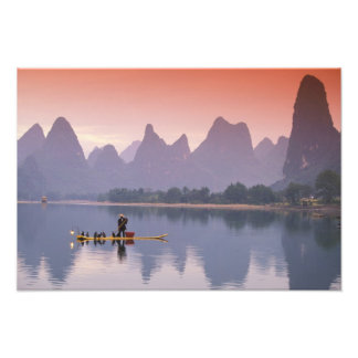 China, Li River. Single cormorant fisherman. Photo