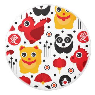 China lucky cat, dragon, and panda ceramic knob
