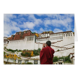 China, Tibet, Lhasa, Tibetan monk with Potala Card