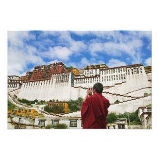 China, Tibet, Lhasa, Tibetan monk with Potala Photo Print