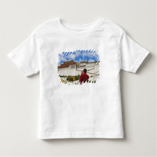 China, Tibet, Lhasa, Tibetan monk with Potala Toddler T-Shirt