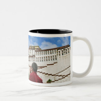 China, Tibet, Lhasa, Tibetan monk with Potala Two-Tone Coffee Mug