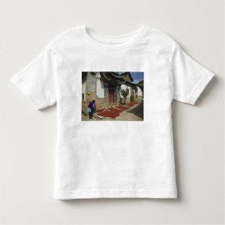 CHINA, Yunnan Province, Tianshengying. Drying Toddler T-Shirt