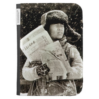 Chinese boy with newspapers case for kindle