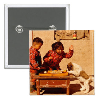 Chinese children playing with a dog pinback button