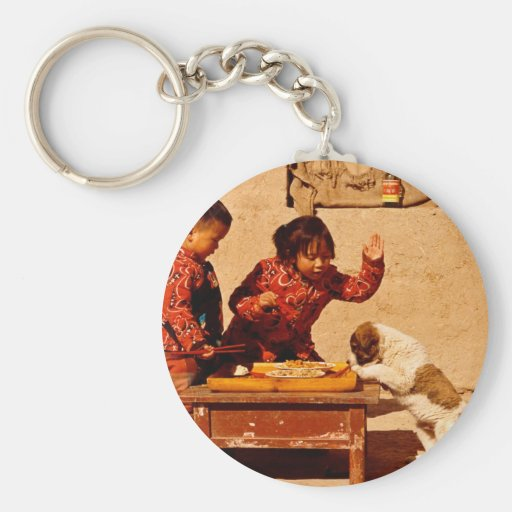 Chinese children playing with a dog key chains