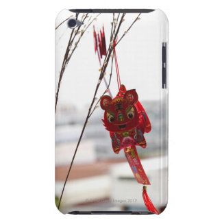 Chinese dragon decoration hanging from branch barely there iPod covers