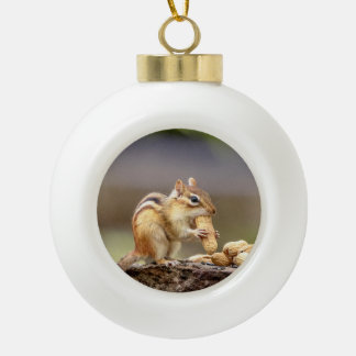 Chipmunk eating a peanut ceramic ball christmas ornament