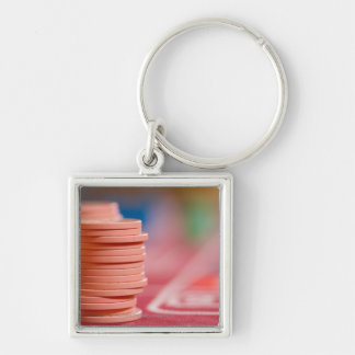 Chips on betting table 2 key ring