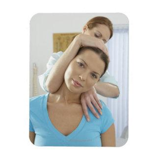 Chiropractic treatment. Chiropractor treating Flexible Magnet