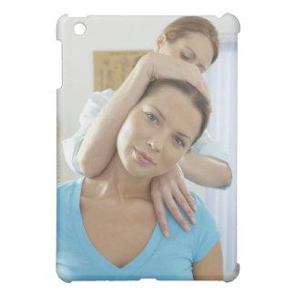 Chiropractic treatment. Chiropractor treating iPad Mini Cases
