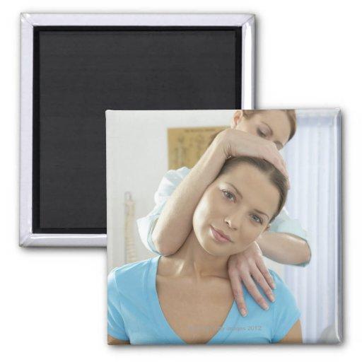 Chiropractic treatment. Chiropractor treating Magnet