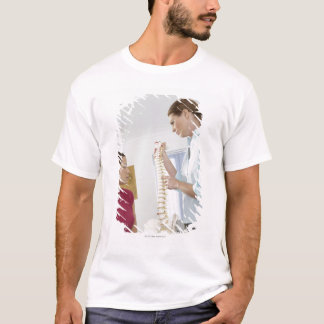 Chiropractor and patient. The chiropractor is T-Shirt