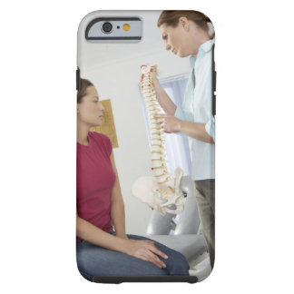 Chiropractor and patient. The chiropractor is Tough iPhone 6 Case