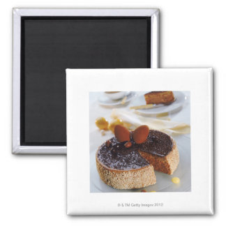 Chocolate cake on plate, close-up square magnet