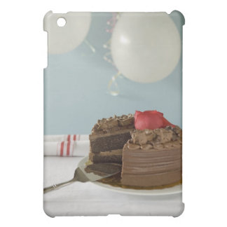 Chocolate cake with missing slice on table, iPad mini case