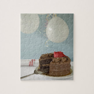Chocolate cake with missing slice on table, jigsaw puzzle