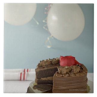 Chocolate cake with missing slice on table, tile
