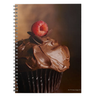 Chocolate Cupcake with a Raspberry topping Notebook