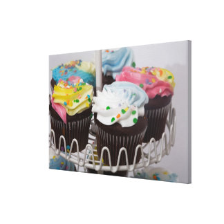 Chocolate cupcakes on a cake stand 2 canvas print