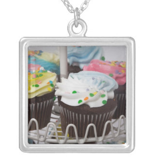 Chocolate cupcakes on a cake stand 2 silver plated necklace