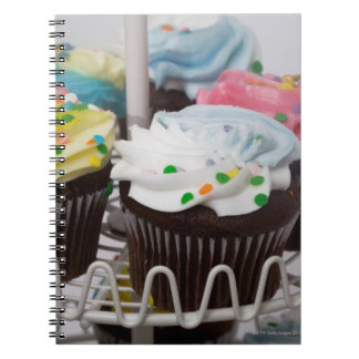 Chocolate cupcakes on a cake stand 2 spiral notebook