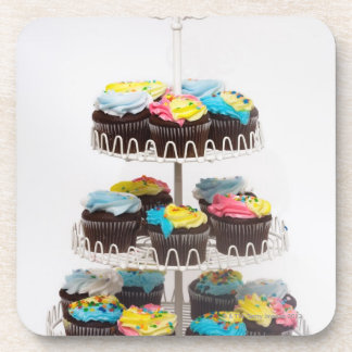 Chocolate cupcakes on a cake stand coaster