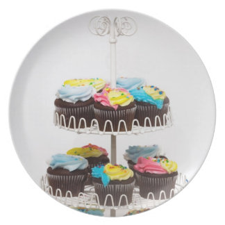 Chocolate cupcakes on a cake stand plate