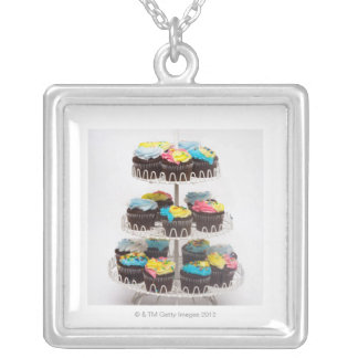 Chocolate cupcakes on a cake stand silver plated necklace