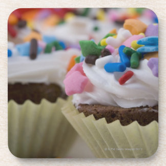 Chocolate cupcakes with icing and sprinkles, coaster