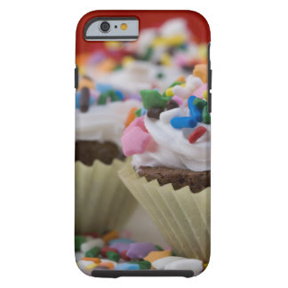 Chocolate cupcakes with icing and sprinkles, tough iPhone 6 case