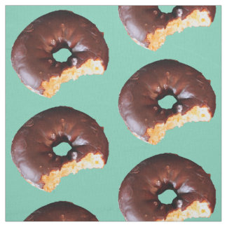 Chocolate Frosted Yellow Cake Donut on Mint Green Fabric