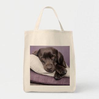 Chocolate labrador retriever dog sleepy on pillows grocery tote bag