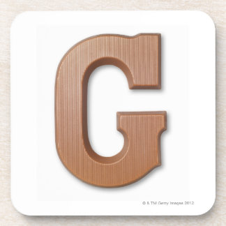 Chocolate letter g beverage coaster