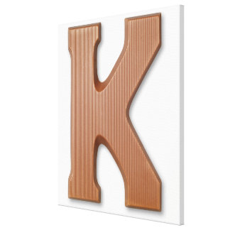 Chocolate letter k stretched canvas print