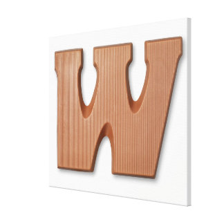 Chocolate letter w stretched canvas prints