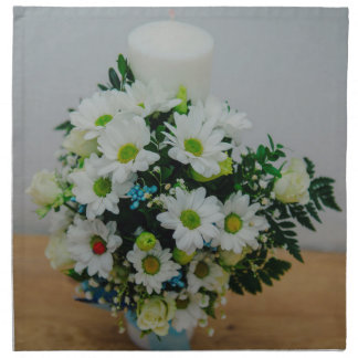Christening candle with white flowers cloth napkins