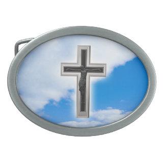 Christian cross at blue sky background belt buckles