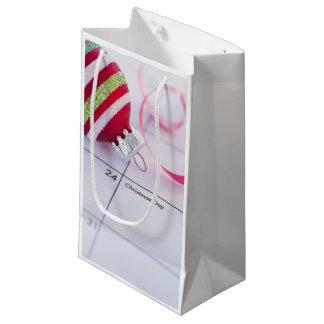 Christmas bauble on calendar small gift bag
