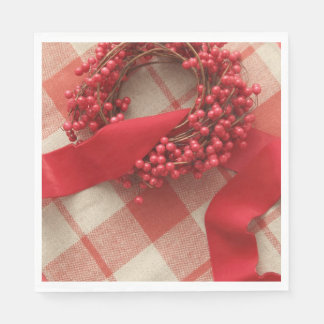 Christmas berries and wreath on plaid paper serviettes