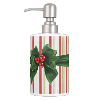 Christmas bow with stripey background soap dispenser and toothbrush holder