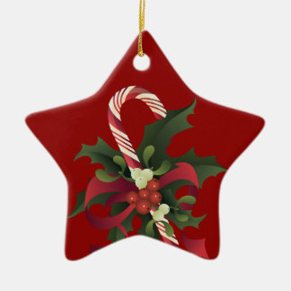 Christmas candy cane in a mistletoe and holly berr christmas ornament