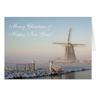 Christmas card windmill in winter at sunrise