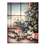 Christmas Carollers in Window Postcard