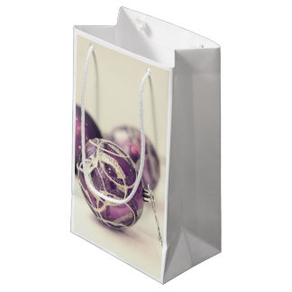 Christmas decoration on white surface small gift bag