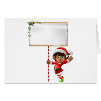 Christmas elf holding a sign cards