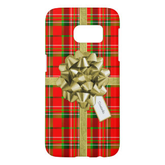 Christmas Gift Wrapped in Red Tartan and Ribbons