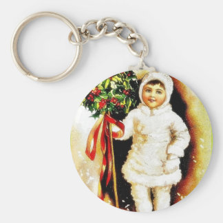 Christmas greeting with a boy holding holy leaves keychain