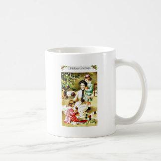 Christmas greeting with a mother playing with kids coffee mug
