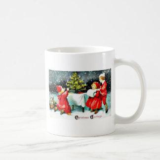 Christmas greeting with children playing around th coffee mugs